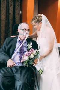 Man living with ALS and bride on their wedding day