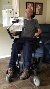 Man sitting in power wheelchair using eye gaze technology
